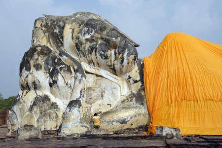 Large stone statue of Lying Buddha in Ayutthaya near Bangkok, Thailand.