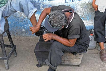 shoe shine man in granada nicaragua Stock Photo