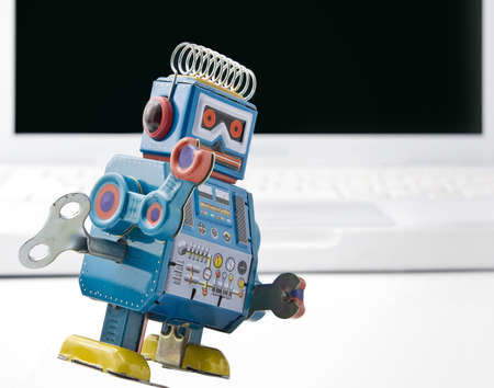 old retro robot toy and laptop Stock Photo - 3656674