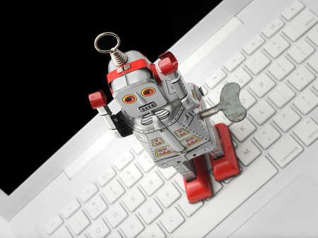 windup: old robot toy on laptop