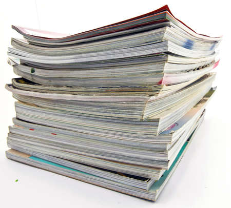 a pile of old magazines on white Stock Photo - 4300953