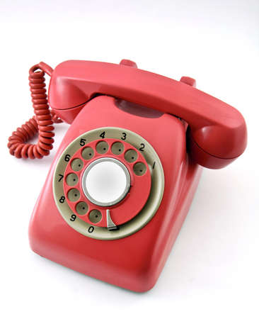 rotary dial telephone: old  red phone