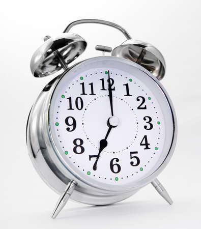 retro alarm clock on white  Foto de archivo