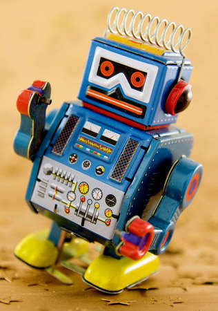 tin robot: retro robot on gold Stock Photo
