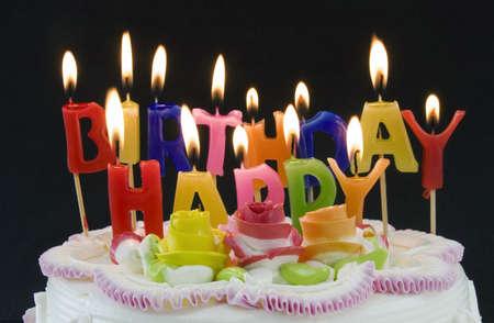 誕生日ケーキと candels 写真素材