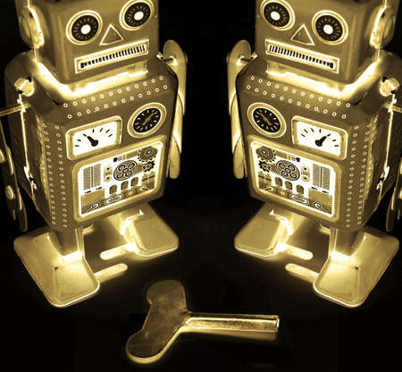 two golden retro robot toy Stock Photo - 6657816