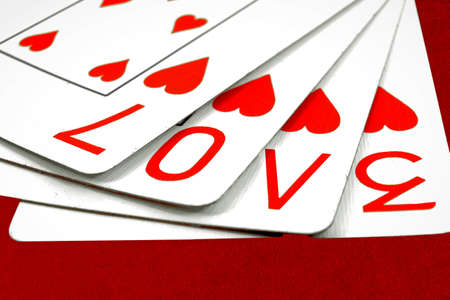 poker game:  playing cards with the word love  Stock Photo