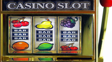 old fruit machine spining photo