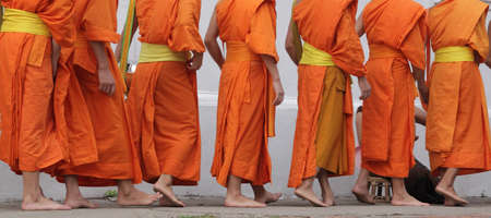 robes: monks walking in lao Stock Photo