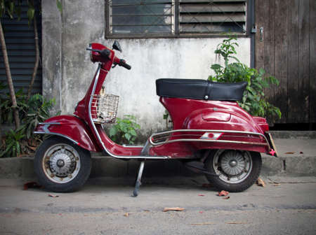 parked old red moped