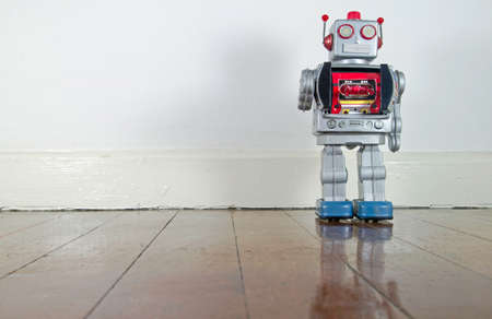 gun room: retro robot on old wooden floor