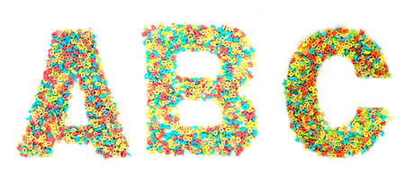 monotype: ABC.. made out of small candy letters Stock Photo