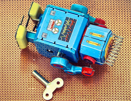 suspiciously: tired robot retro robot toy Stock Photo