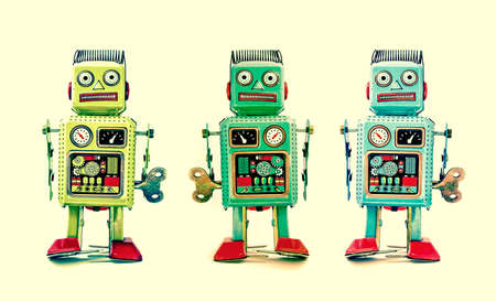 discredit: three robot toys in a line Stock Photo
