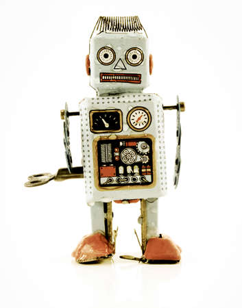 suspiciously: wet dejected robot toy Stock Photo