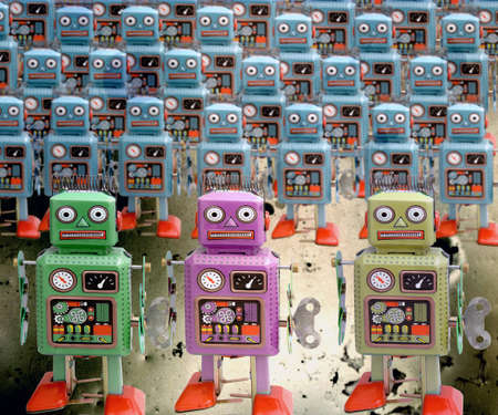 uniformity: a large group of retro robots Stock Photo