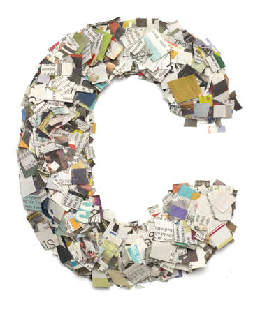 newspaper print: The letter C  made from newspaper confetti