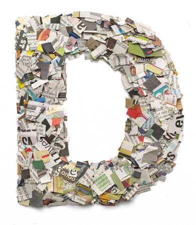 papier lettre: La lettre D fabriqu� � partir de confettis de journaux Banque d'images