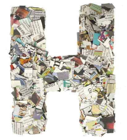 cuttings: The letter H  made from newspaper confetti Stock Photo