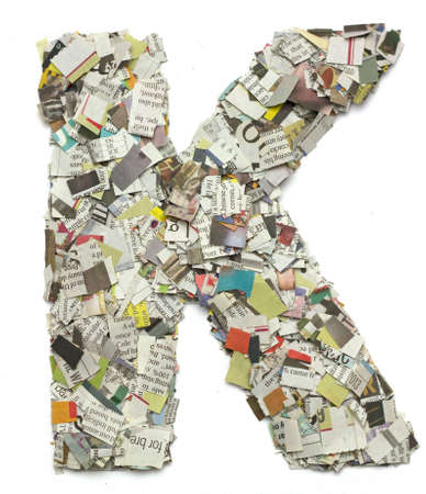 letter k: The letter K  made from newspaper confetti