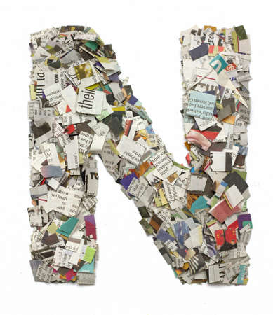 The letter N made from newspaper confetti 스톡 콘텐츠