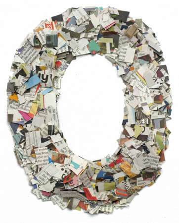 cuttings: The letter O  made from newspaper confetti Stock Photo