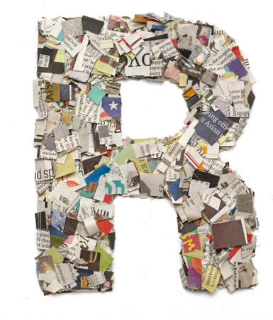 r: The letter R  made from newspaper confetti