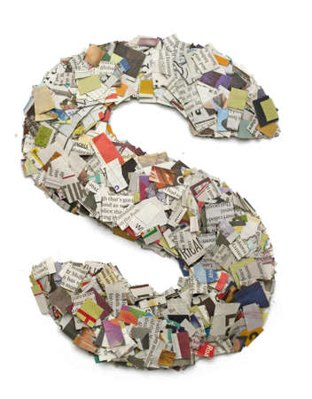 The letter  S made from newspaper confetti 版權商用圖片