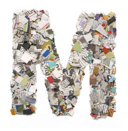 newsprint: The letter  M  made from newspaper confetti