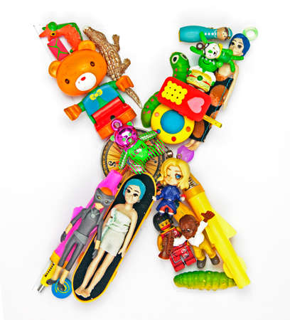 the letter     X  made from small toys Stock Photo