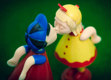 two old plastic toys kissing