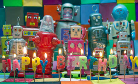 childrens birthday party: Happy Bithday candels and vintage robot toys