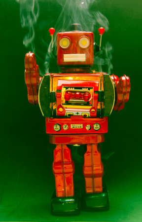 retro robot toy with smoke and sparkes