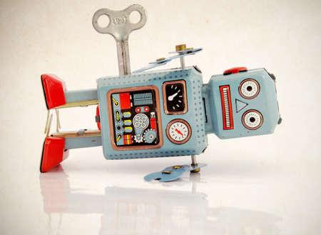power failure: blue vintage robot toy in shock