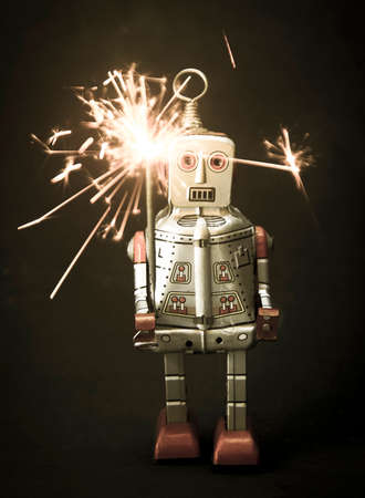 fire works: robot and sparkes Stock Photo