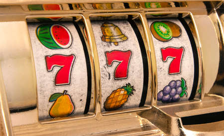 wheel spin: slot machine 777 close up Stock Photo