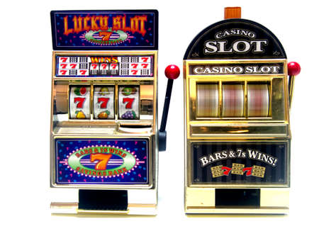 wheel spin: two vintage toy slot machines with gold money