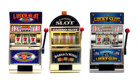 Three  vintage toy slot machines with gold money