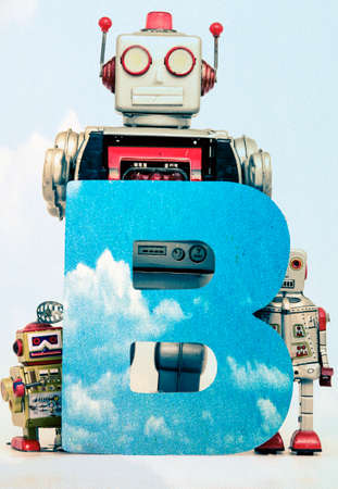 B for blue sky with vintage robot toys