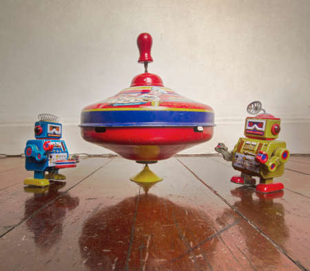 vintage spinning top and two small robot toys Stock Photo