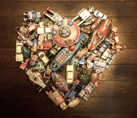 collectible: a large colection of tin toys in a heart shape
