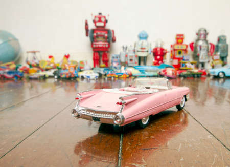 classic pink car toy on wooden floor