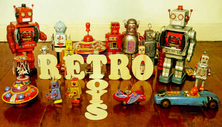 vintage toys on a wooden floor with reflection