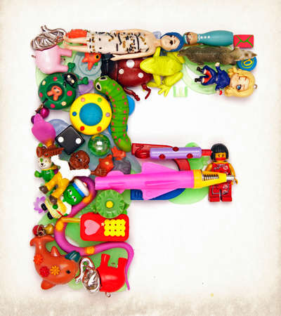 the letter F made from small toys Stock Photo