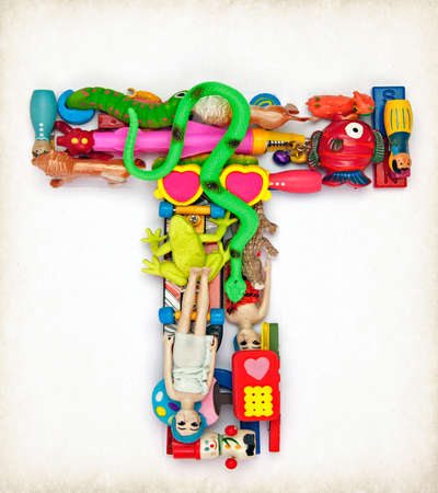 the letter    T  made from small toys
