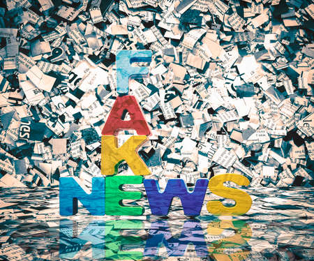 newspaper confetti and wooden letters ake nes Stock Photo