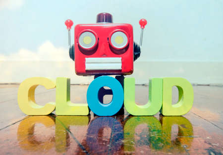 red retro robot head on the word CLOUD  on old wooden flor  Stock Photo