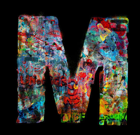 lots of small wooden letters to make up the letter M Stock Photo