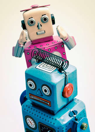 relationship troble concept with retro robot toys