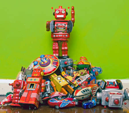 robot toy stands on the oppresed Editorial